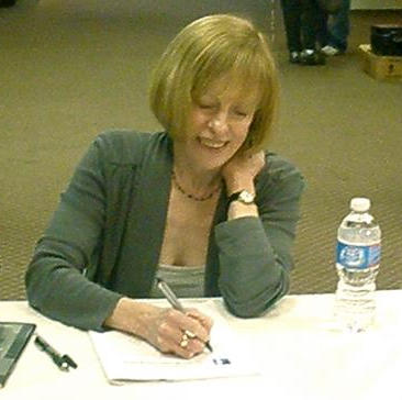 Martha Collins signs books.